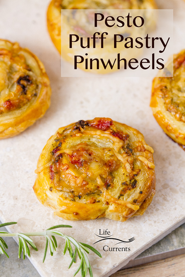 Pesto Puff Pastry Pinwheels with Sun Dried Tomatoes and Roasted Red Peppers are elegant appetizers that'll impress your guests.