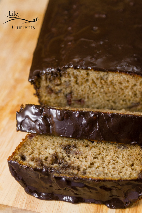 Cherry Bread with Dark Chocolate Glaze Recipe is a moist delicious bread that's filled with cherry flavor from cherry juice and cherry preserves jam, then topped with a delicious dark chocolate glaze icing.