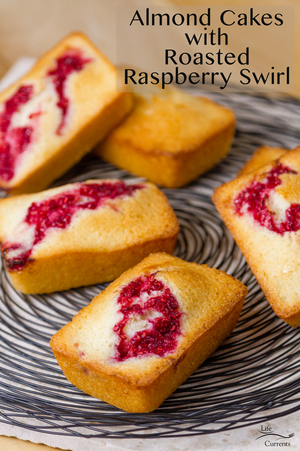 Almond Cakes with Roasted red Raspberry Swirl out on a wire rack ready to be served with text describing the title of the recipe