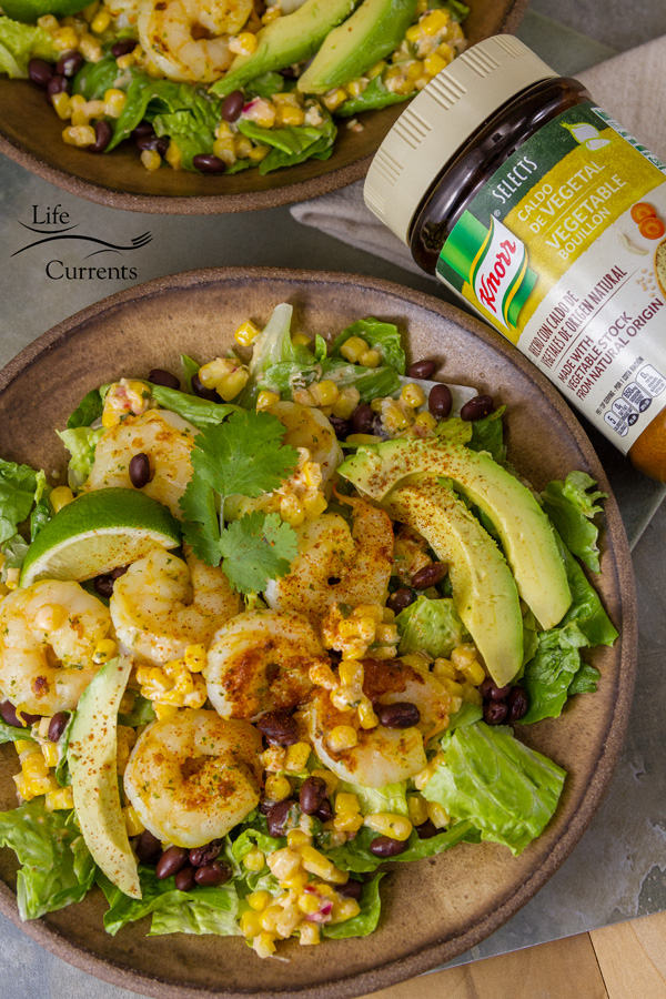 This Shrimp and Mexican Street Corn Bowl with avocado in a brown bowl with a bottle of Knorr next to it