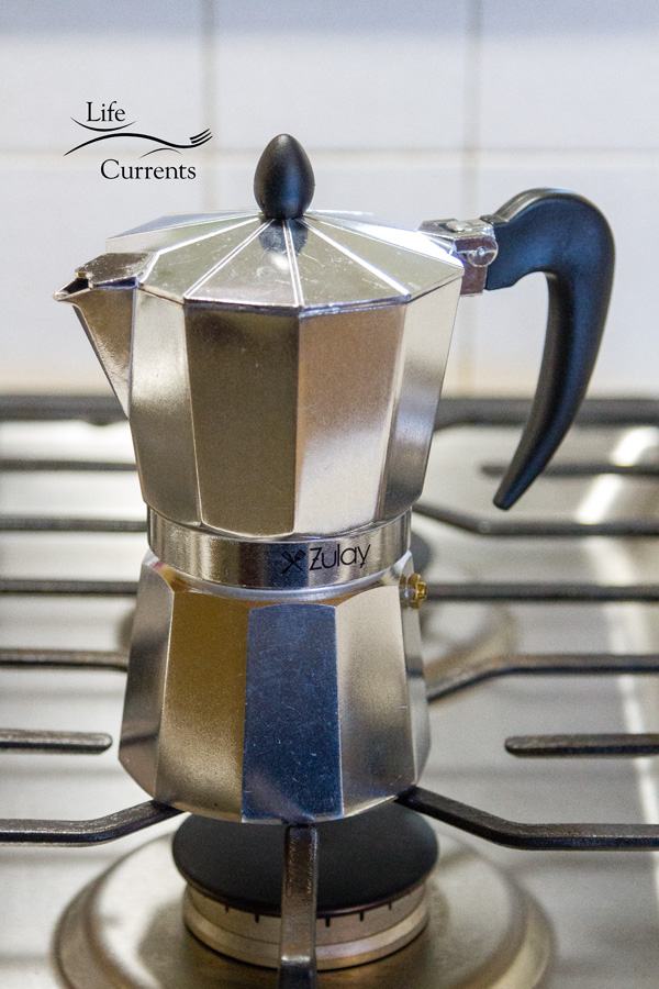 The Zulay stovetop espresso maker on the stovetop