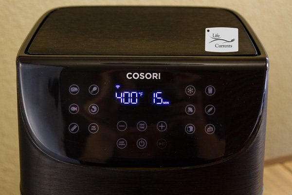 The control panel of the COSORI air fryer showing 400 degrees and 15 minutes