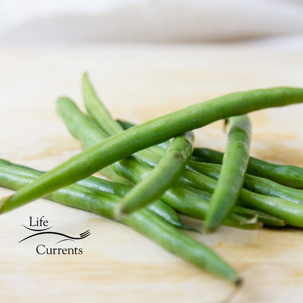 Fresh green beans, stacked up on top of each other