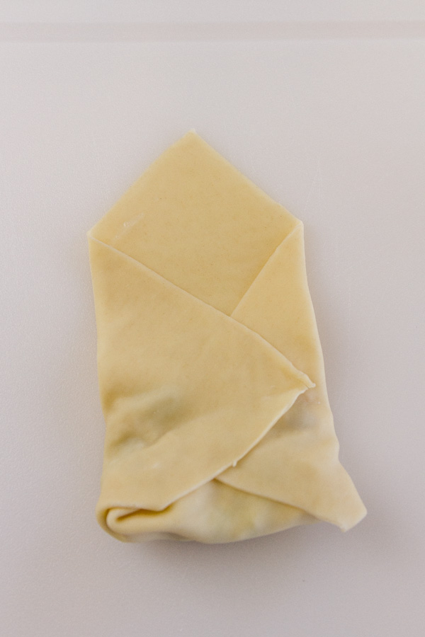 How to roll an Egg Roll: fold in the sides so that the filling is contained.