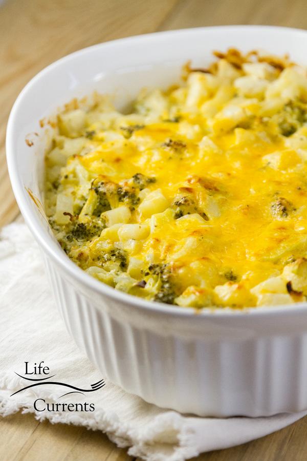 broccoli potato casserole in a white casseole dish on a white napkin
