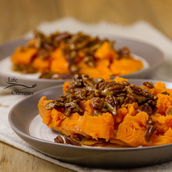 square crop two sweet potato halves with pecan sauce