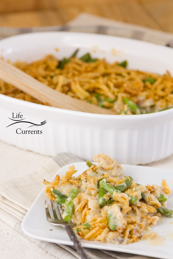 A serving of green bean casserole in front of the casserole dish