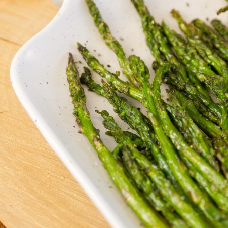 air fryer cooked asparagus as a side dish on a platter