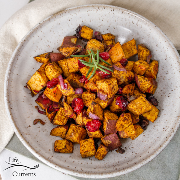 square crop of air fryer roasted sweet potatoes in a white bowl