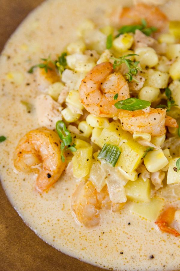 close up of Cajun seafood chowder with lots of shrimp, corn, potatoes, and tuna