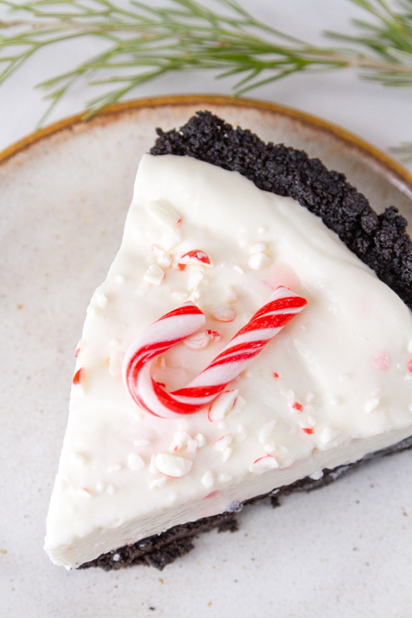 a slice of Candy Cane Pie topped with a candy cane