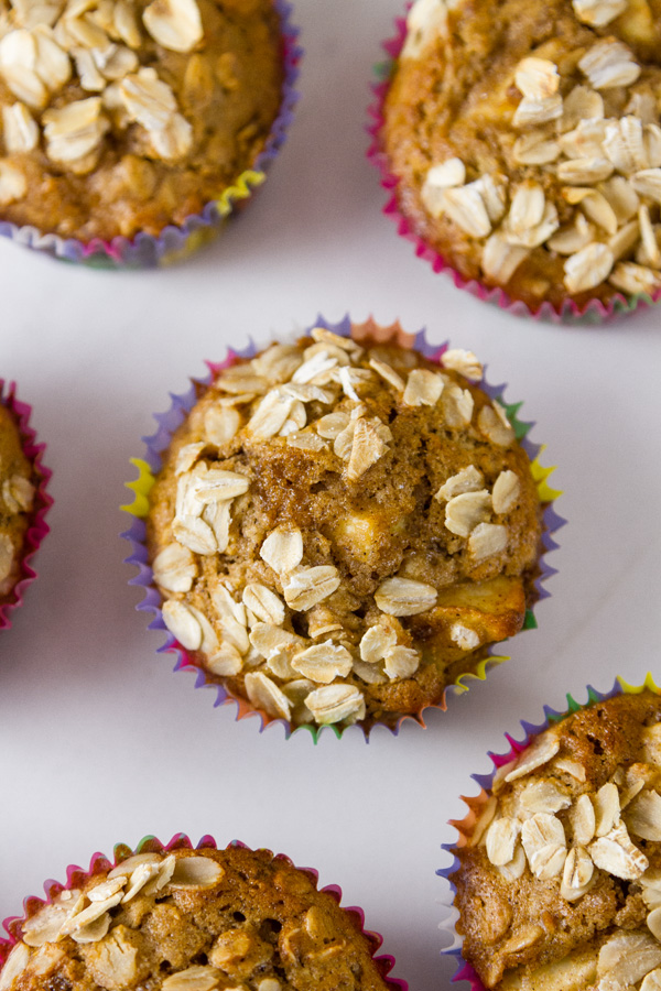 top down view of apple oatmeal muffins in paper liners