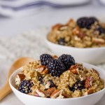 two bowls of Breakfast Quinoa Bowl with Blackberries with a blue striped cloth in the background