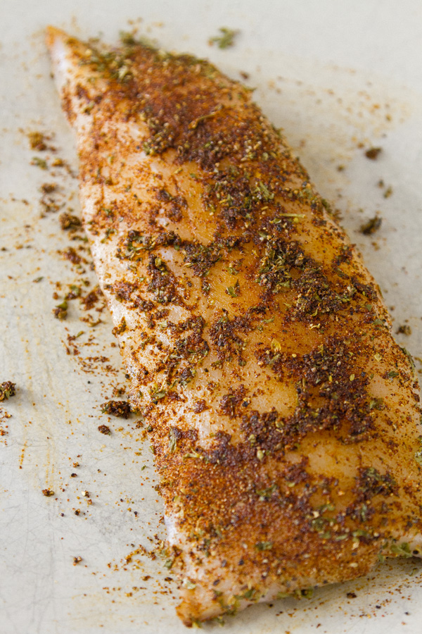 raw Wild Alaskan Pacific Cod that's been rubbed with spices for Air Fryer Chili-Lime Cod Fish Tacos