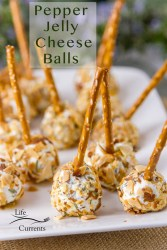 Pepper Jelly Cheese Balls on a white plate with pretzle sticks as handles with the title