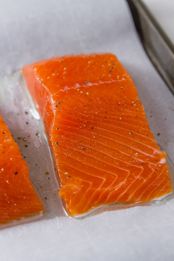 Super fresh COHO Salmon cut into fillets on a baking tray
