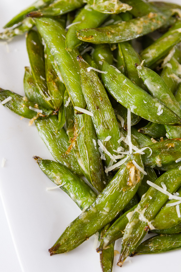 close up of Air Fryer Parmesan Sugar Snap Peas on a white plate