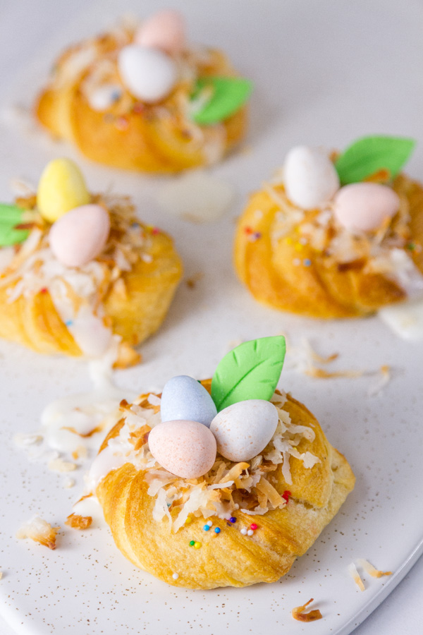 Easter Crescent Nests on a white plate with some coconut spilled around