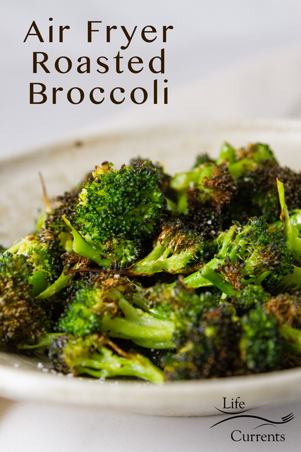 Air Fryer Roasted Broccoli in a white bowl