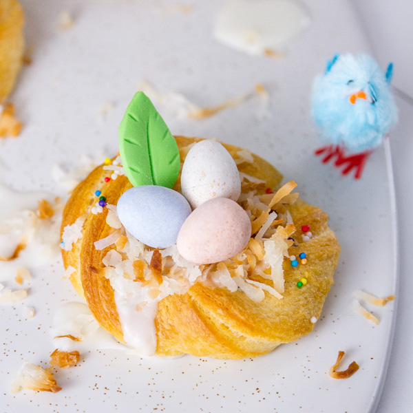 Single Easter Crescent Nest with a blue Easter chick next to it