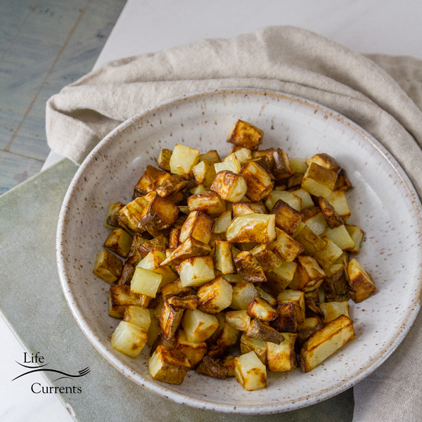 square crop of Air Fryer Potatoes in a white bowl