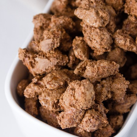 Mocha Candied Almonds in a white ceramic dish for serving