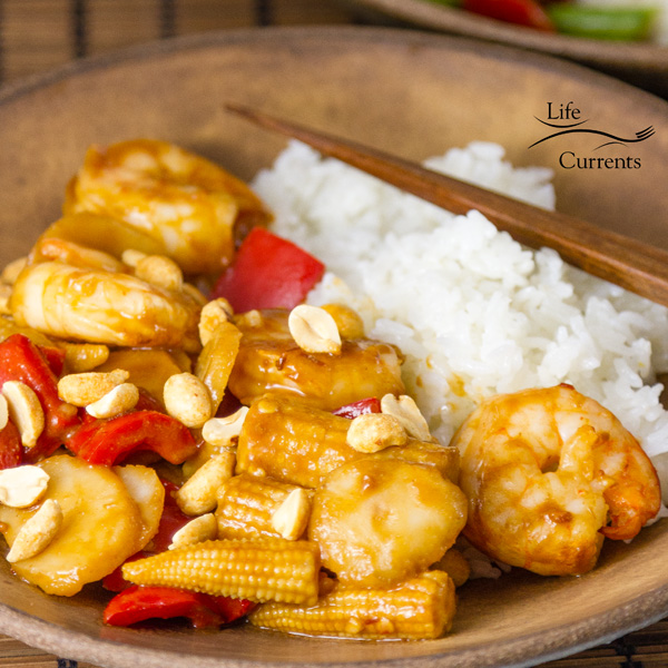 square crop of Air Fryer Shrimp in a brown bowl with rice and chopsticks
