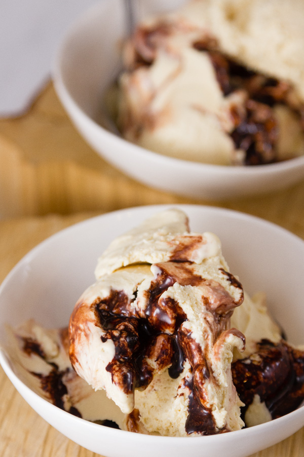 Peanut Butter Fudge Ripple Ice Cream in two bowls on a wood background