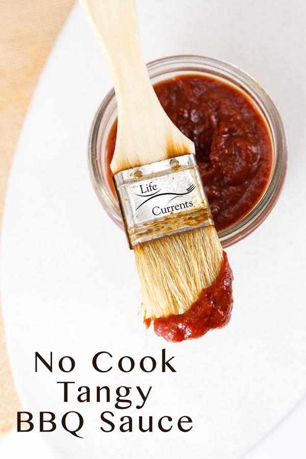 a top down look at a jar of Zesty No-Cook BBQ Sauce with a pastry brush that's been dipped in the sauce and the title in the lower left