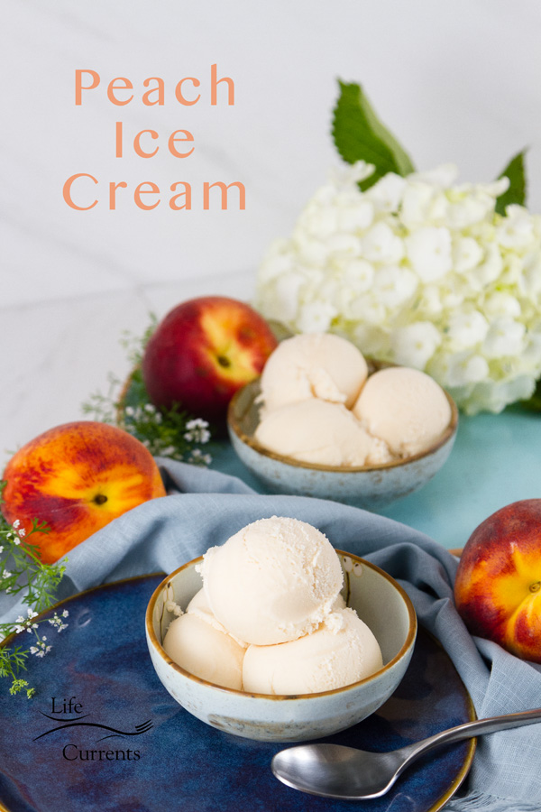 two bowls of peach ice cream on blue plates with peaches around and some flower. Title on image: Peach Ice Cream