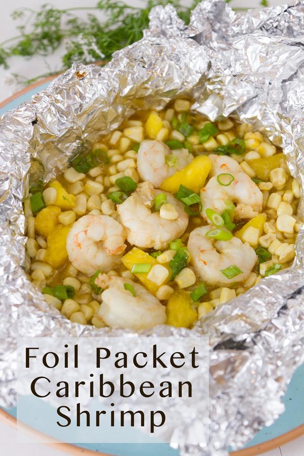 title on lower left: Foil Packet Caribbean Shrimp. Foil packet open to reveal the shrimp, corn, and pineapple inside