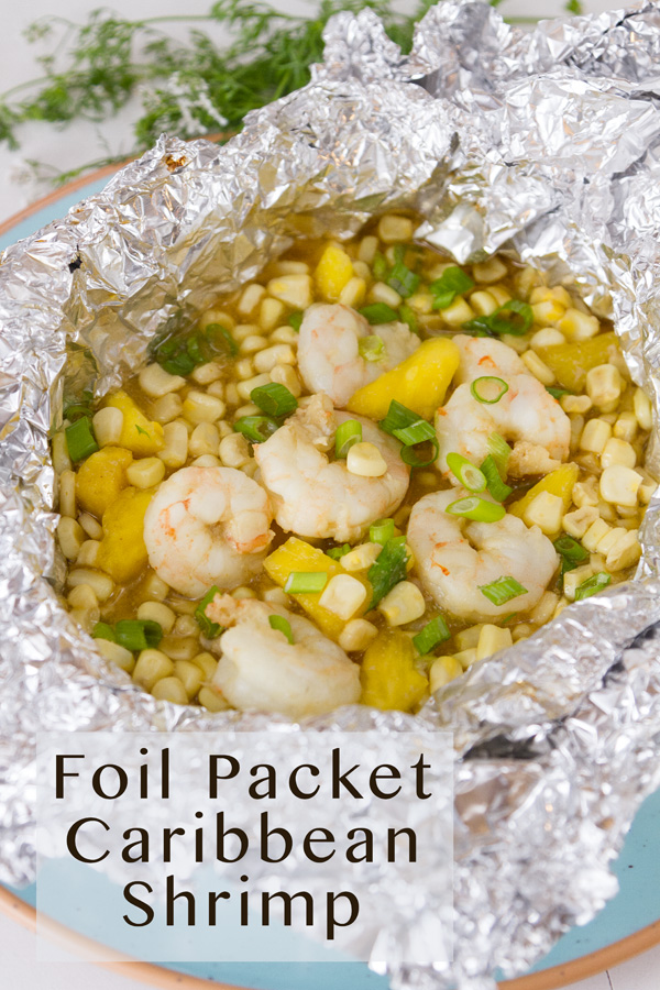 title on lower left: Foil Packet Caribbean Shrimp. Foil packet open to reveal the shrimp, corn, and pineapple inside