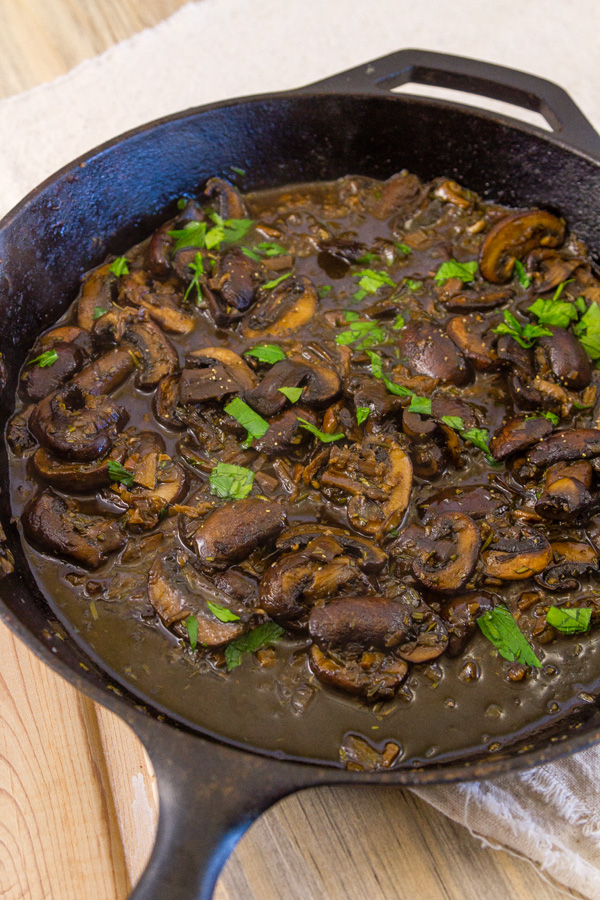 freshly cooked Mushroom Ragout in a cast iron skillet garnished with parsley