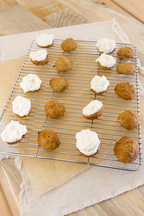 cookies laid out, some with frosting, some without