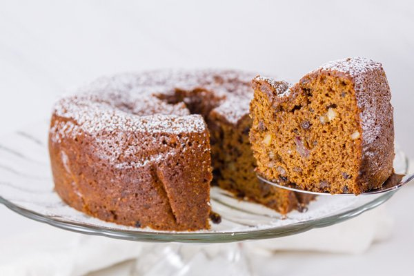 horizontal crop of cake with a slice being taken out
