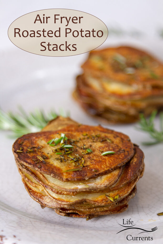 two stackes of sliced roasted potatoes with fresh rosemary, title on top of image: