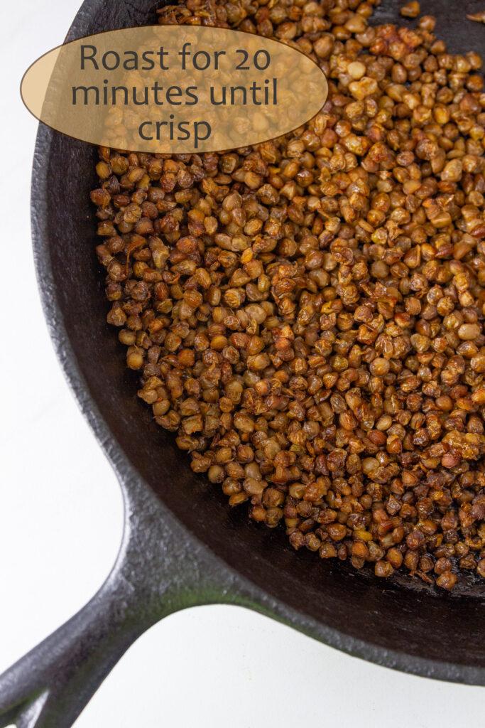 roasted lentils in a cast iron skillet, title on image: Roast for 20 minutes until crisp.