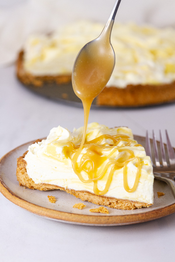 drizzling caramel sauce over a slice of pie.