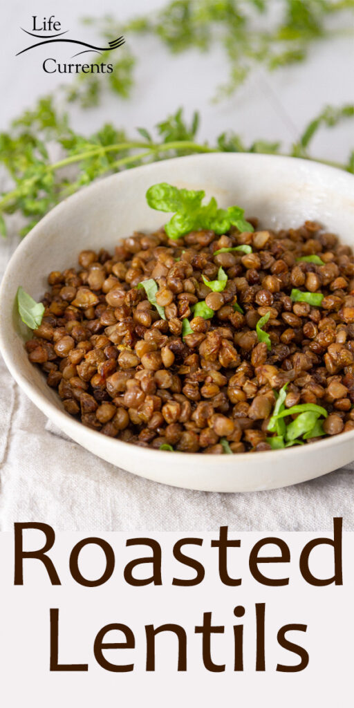 a white bowl filled with roasted lentils and garnished with green herbs, title on image.