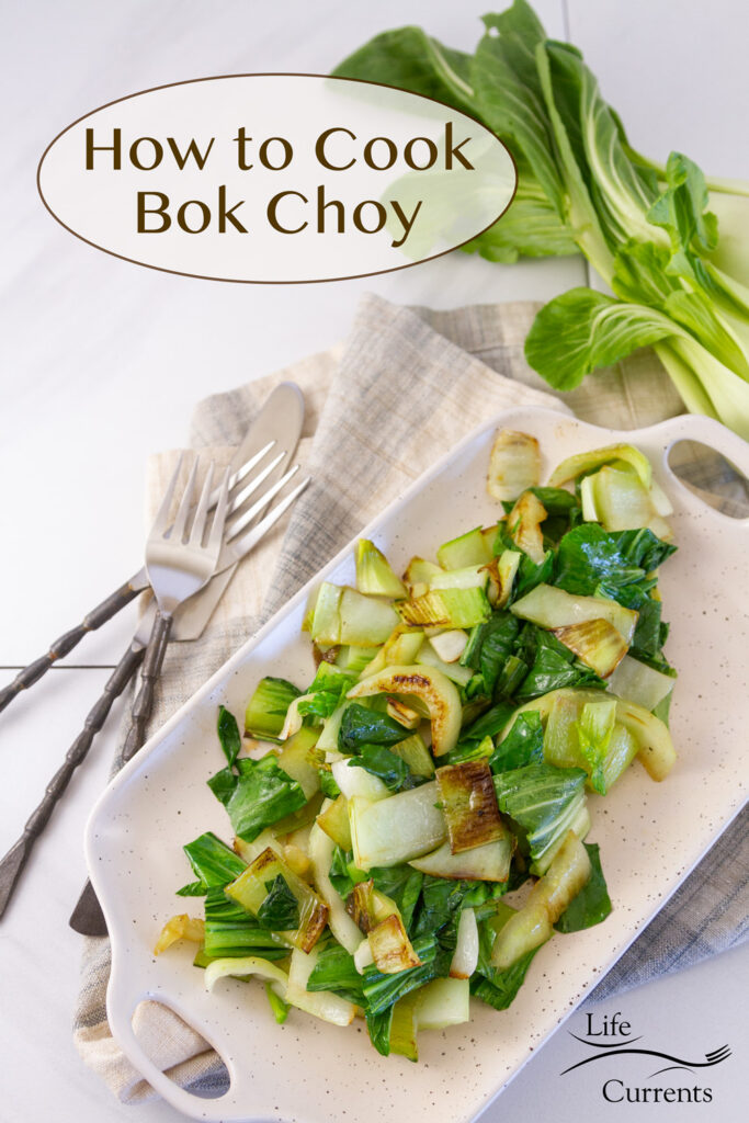cooked bok choy on a serving platter with forks, knife, and fresh bok choy around it, title on image: How to Cook Bok Choy.