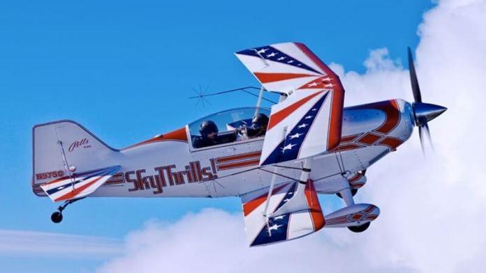 Soaring skyward in a SkyThrills biplane.