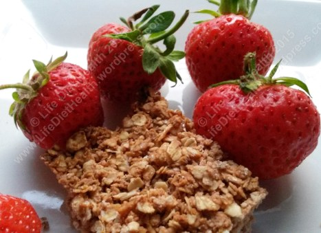 Organic garden strawberries go beautifully with this coconut maple flapjack.