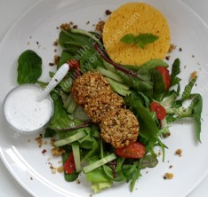 Green banana nut cutlets served on mixed leaves