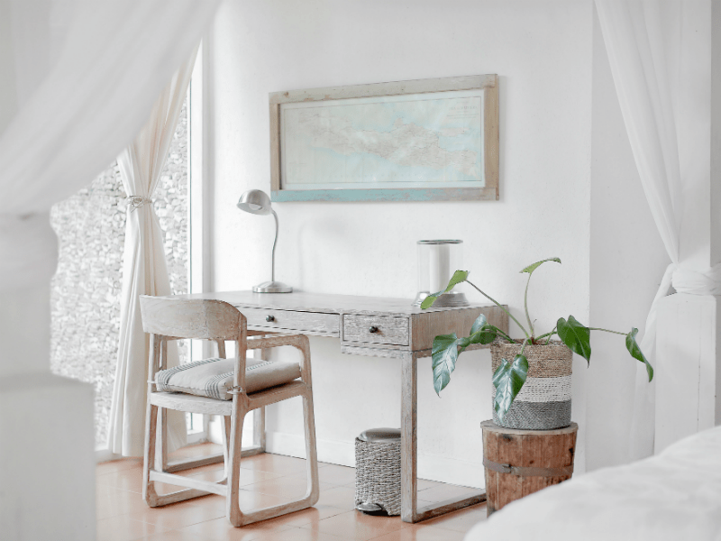 white room with desk, curtains and plant. modern and clean vibe
