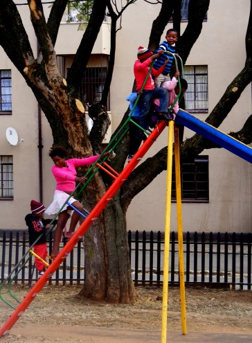 The children are enjoying a Saturday morning playing in the park