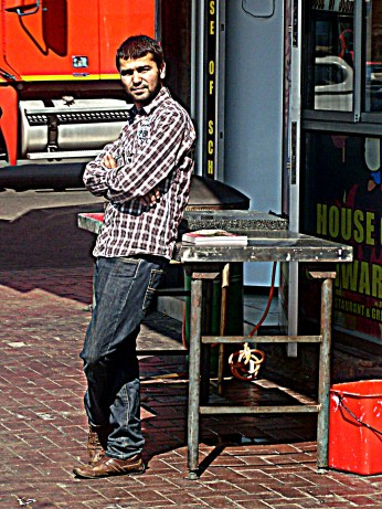 One of the restaurant owners looking out onto the street before they got busy for the day
