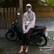 Driving motorbike in Indonesia