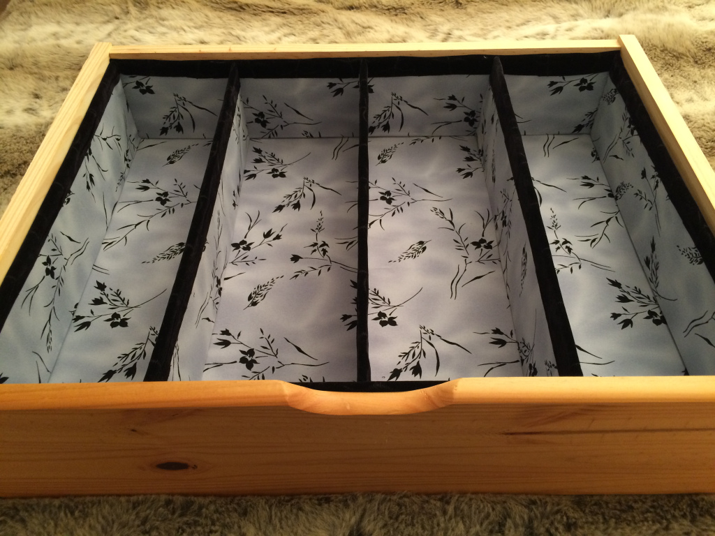 Completed project showing DIY drawer dividers made from foamboard and fabric.