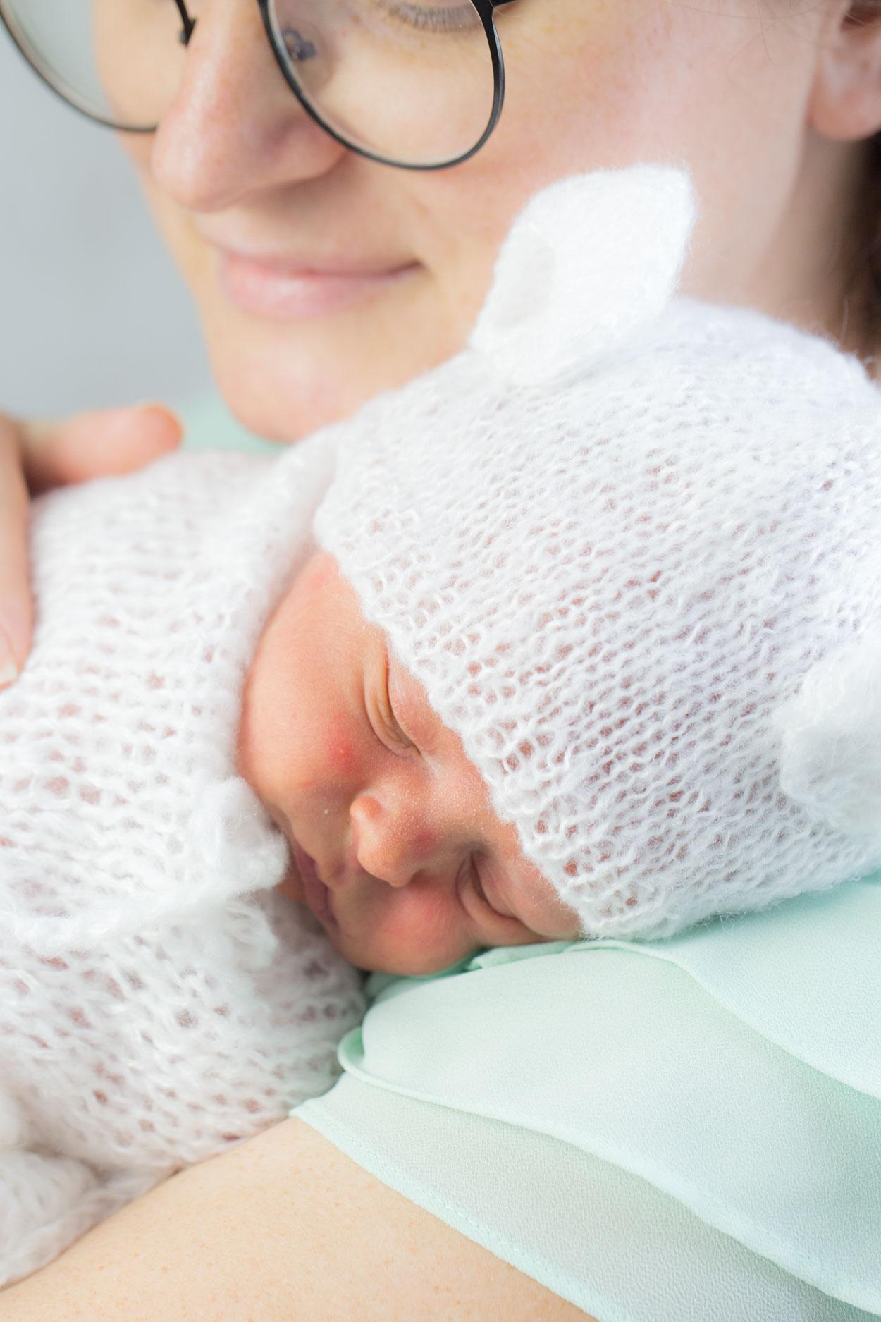 Baby resting on mom's shoulder.