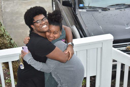 brown skin kids hugging at Myrtle Beach South Carolina during thanksgiving